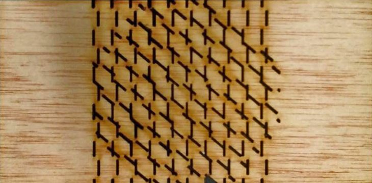 The wooden panel with the laser cut pattern